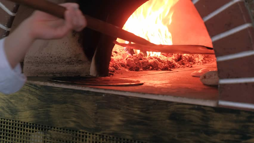 pizza baking in a wood fired oven 4k