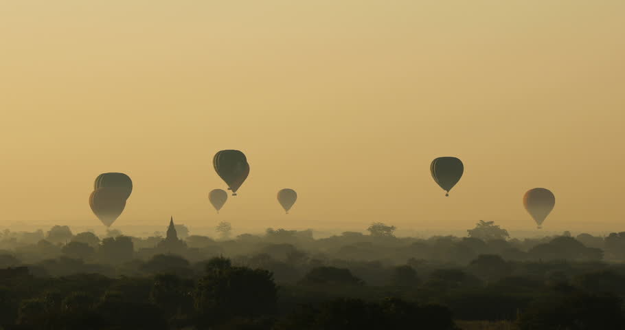 BAGAN, MYANMAR – JANUARY 2, 2018: Hot air balloons over the ancient Buddhist temples in Bagan #34618258