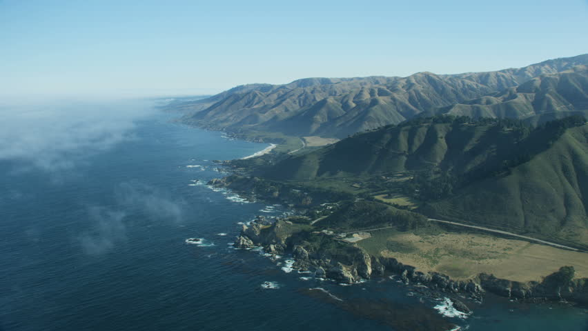 Aerial coastline view around Rocky Point to coastal mountain ranges and offshore ocean fog Big Sur California USA RED WEAPON