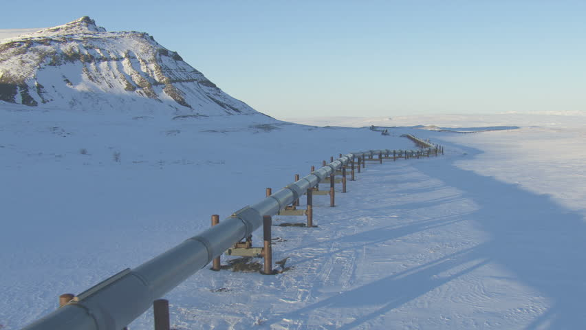 Aerial winter view of Trans Alaska pipeline from Prudhoe Bay crude oilfields and the Dalton Highway Brooks Mountain Range Alaska USA