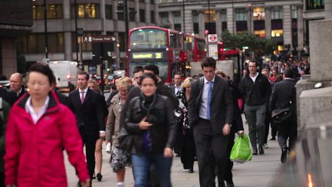 LONDON - OCTOBER 10, 2011: People on Bridge during the rush hour
