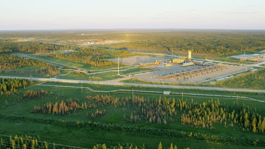 Aerial sunset view of an Oil Refinery production site within Athabasca tar sands near Fort McMurray Northeast Alberta Canada RED WEAPON