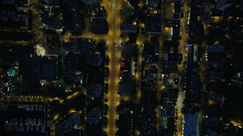 Aerial overhead night view illuminated lights downtown Vancouver and evening commuter travel on city streets British Columbia Canada RED WEAPON