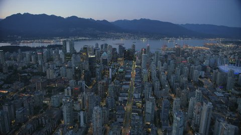 Vancouver Canada - Sept 2017: Aerial dusk view illuminated evening lights downtown Vancouver city and harbour to North Shore Mountains British Columbia Canada RED WEAPON