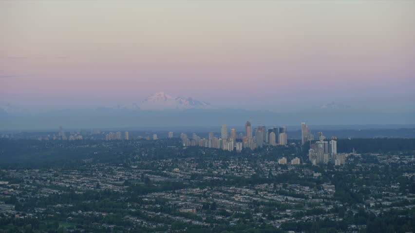 Aerial view residential suburbs east Vancouver city snowcapped North Shore Mountains Mount Baker Burnaby District British Columbia Canada RED WEAPON