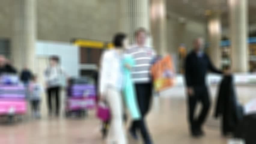 Blurred view of passengers In Arrival hall of Terminal 3 of Ben Gurion Airport. It considered to be among best airports in the Middle East  | Shutterstock HD Video #34644238