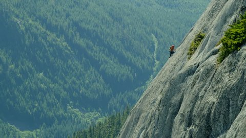 Aerial of Caucasian climbing team expedition on the rocky extreme wall of Mount Habrich in Squamish Valley Canada RED WEAPON