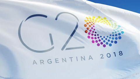ARGENTINA BUENOS AIRES NOVEMBER 2018:  G20 2018 Group of Twenty Meeting flag waving in slow motion against blue sky, editorial animation, seamlessly looped, close up, isolated on alpha channel.