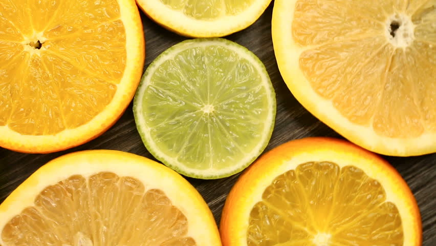 Fresh citrus fruits. Rotation Video footage of the concept of healthy eating and diet. Spinning sliced oranges, lime, lemon, grapefruit   Shutterstock HD Video #34747378