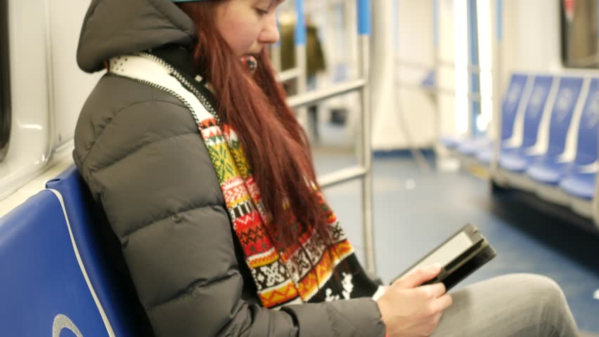 Young woman read e-book in subway train at metro | Shutterstock HD Video #34752238