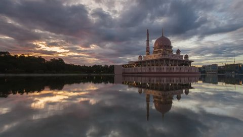 Sunrise Time Lapse at a Mosque by a lake in Putrajaya, Malaysia. Zoom Out Motion Timelapse.