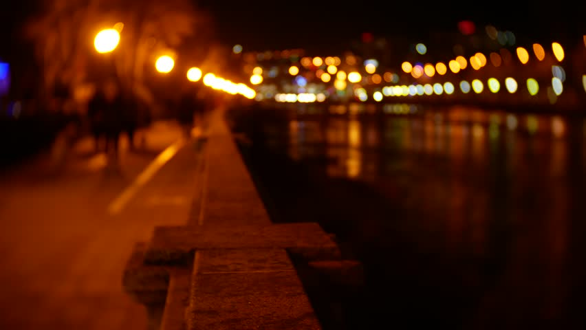 People stroll along the embankment strewn with evening lights. blur. 4K bokeh | Shutterstock HD Video #34796638