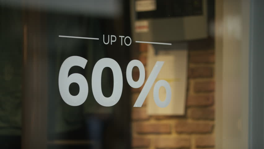 Sale sign showing a discount of goods in a shop window | Shutterstock HD Video #34809238