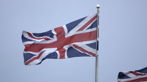 Low angle view of Union Jack British flags in the breeze