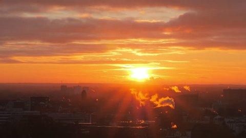 Beautiful sunrise over city. Lubeck, Germany.