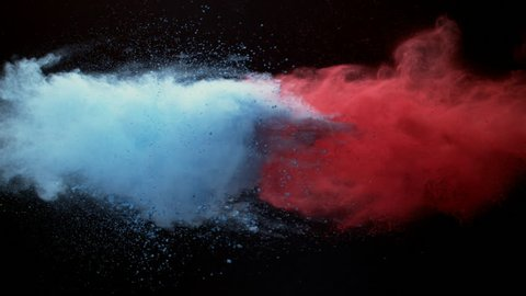 Colorful powder. red powder, blue powder,Powder exploding against black background. Shot with high speed camera, Slow Motion.