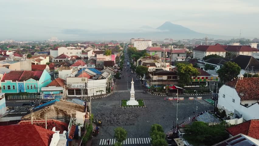 Yogyakarta - Indonesia. January 09, 2018: Aerial landscape of historical Jogja monument from a drone flying forward with Mount Merapi background. Shot in 4k resolution