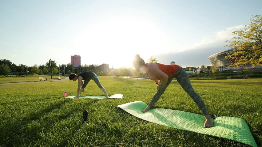 Yoga at park. Two girls exercising outdoors. Concept of healthy lifestyle. | Shutterstock HD Video #34896208