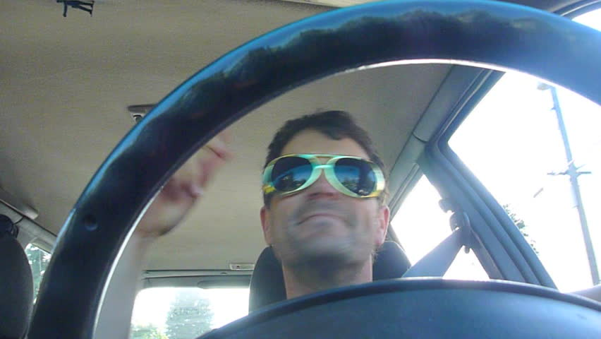Funny clip series of model released man driving car, dancing and listening to music.