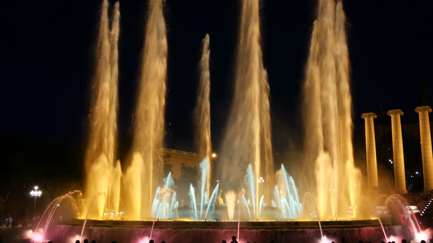 Barcelona Magic fountains attraction, a lot of tourists looking at colorful night show with different water shapes at late evening. Montjuic fontaine, Font magica de Montjuc.   Shutterstock HD Video #34910338