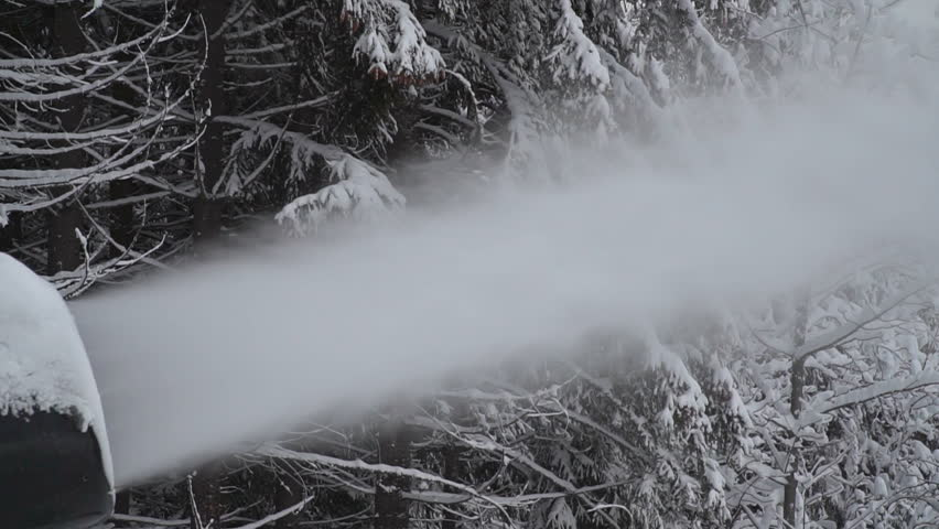 The snow cannon makes artificial snow on the slope of the mountain ski resort. Winter sports. Leisure | Shutterstock HD Video #34932247