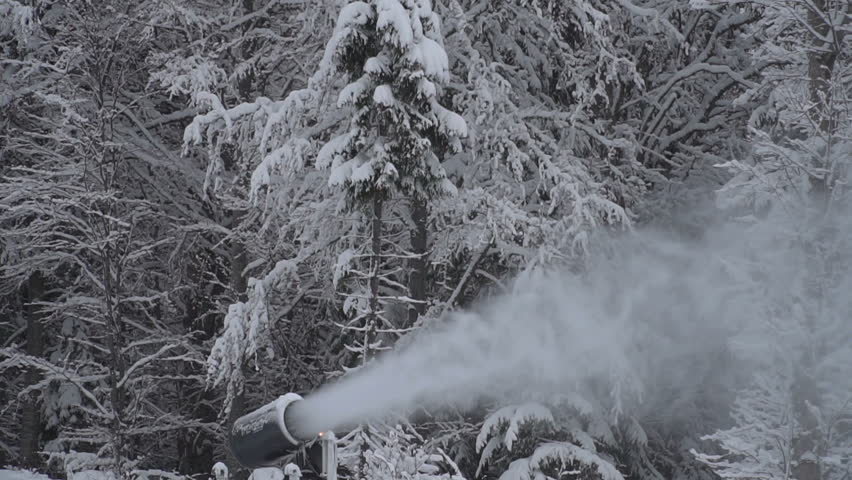 The snow cannon makes artificial snow on the slope of the mountain ski resort. Winter sports. Leisure | Shutterstock HD Video #34932280