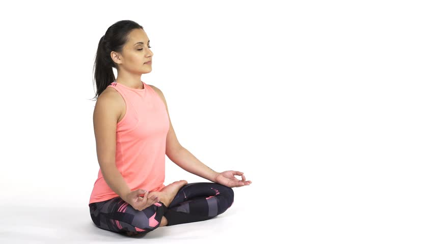 Young attractive woman practicing yoga, doing Padmasana, lotus pose in full length, isolated over white studio background | Shutterstock HD Video #34963948