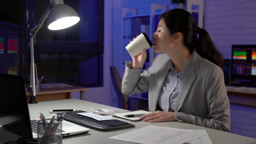 Fast forward of busy young businesswoman working late with global business at startup stock market office | Shutterstock HD Video #34981153
