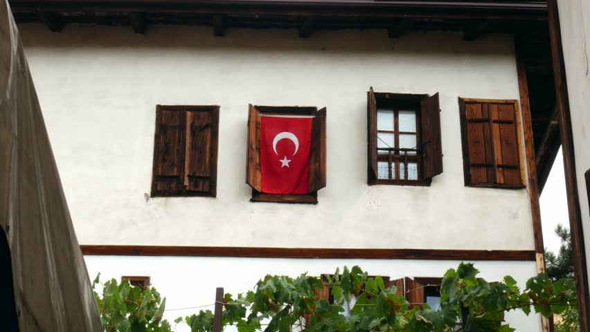 Turkish flag hanging on an Ottoman-style house. 4K | Shutterstock HD Video #34981528