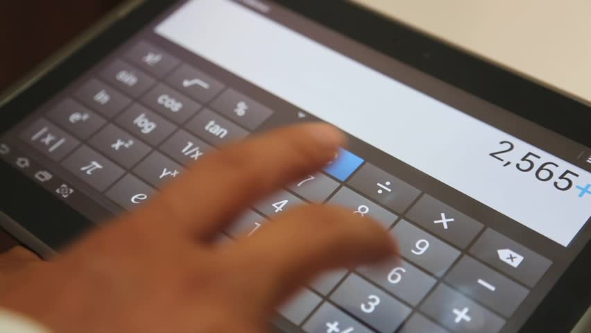 Using Digital Calculator on Tablet Screen | Shutterstock HD Video #34996003