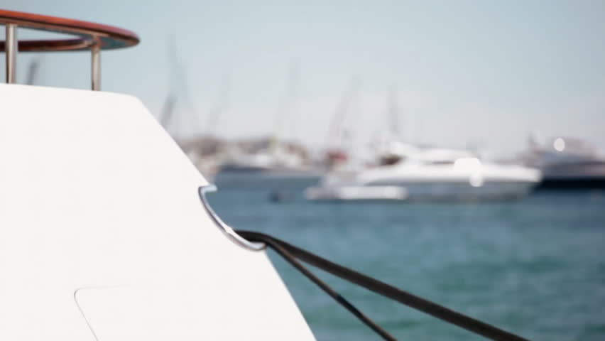 Luxury super yachts at anchor in Cannes, with focus pull both in and out of foreground yacht stern. | Shutterstock HD Video #3501008