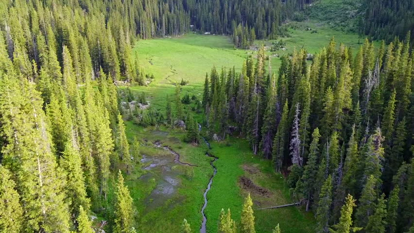 At over 13,000 feet drone glides over a secluded nature preserve in front of the highest peak in New Mexico. Wheeler Peak. Taos, New Mexico.