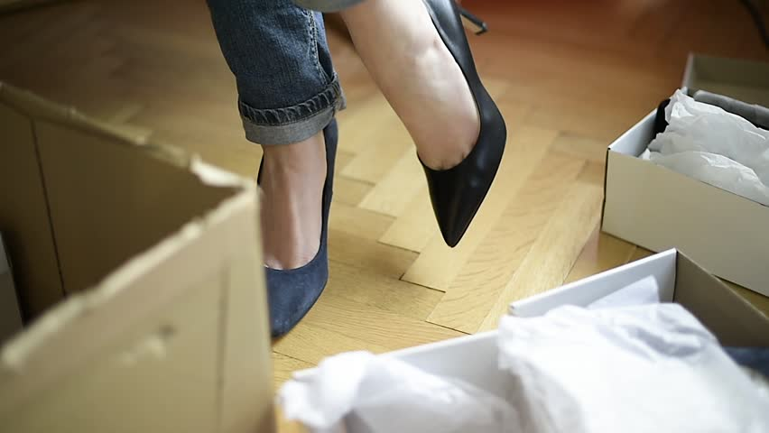 French elegant woman measuring multiple fashion shoes bought online from internet from Italian brand - cat inspecting box during unboxing unpacking | Shutterstock HD Video #35016397