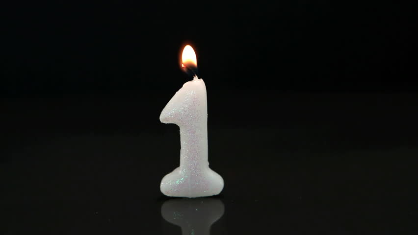 First Birthday Candle On Black Background