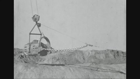 CIRCA - 1936 - Material is moved by large machinery run by diesel for a levee on the Mississippi River near Arkansas City.