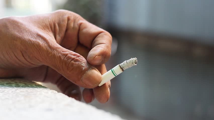 Cigarette in hand of a man. Closeup a cigarette holding in hand of a male. Smoking causes cancer and emphysema. Health Care concept. | Shutterstock HD Video #35074018