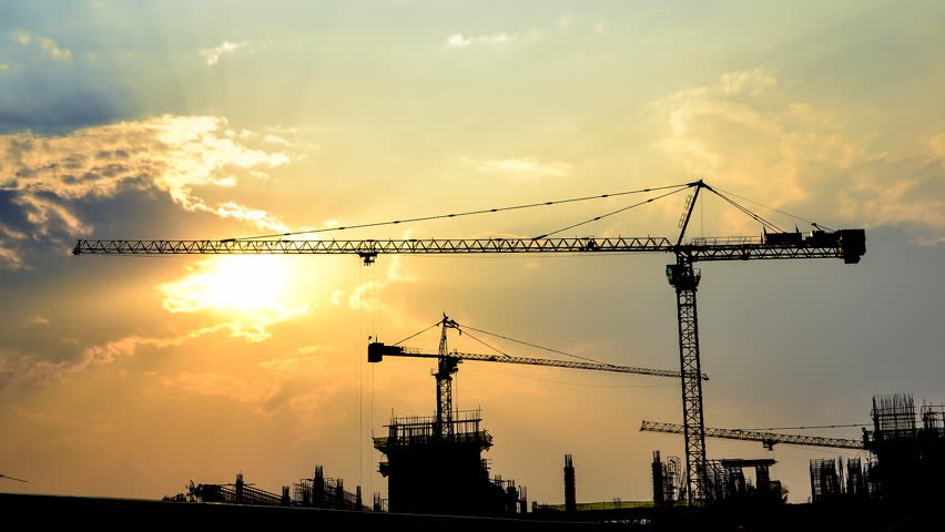 time lapse sunset and silhouette crane working in construction site #3528413