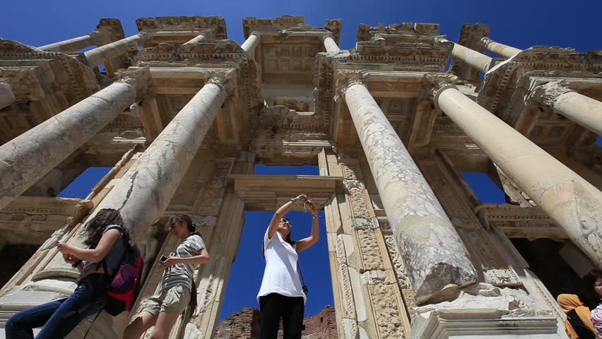 SELCUK, TURKEY - JUNE 10: People visit Celsus library in Ephesus and tourists on June 10 2012 in Selcuk.