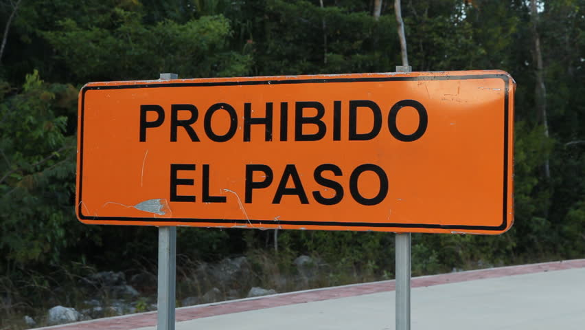 Road sign that says Prohibido el Paso, or Prohibited to Pass. Tulum, Quintana Roo, Mexico.