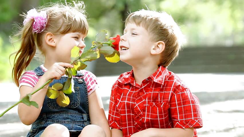 Two children speaking and boy presents flower   Shutterstock HD Video #3542858