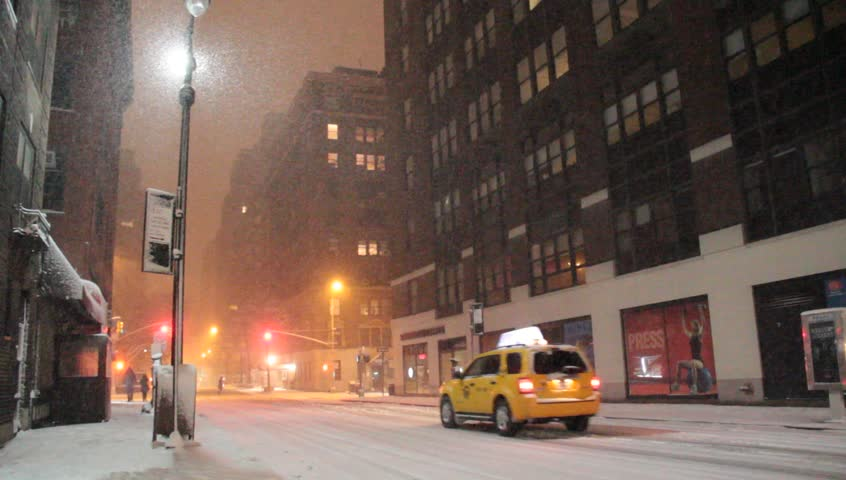 New York, NY - Circa 2012: An empty street during a heavy snow storm with few cars at night