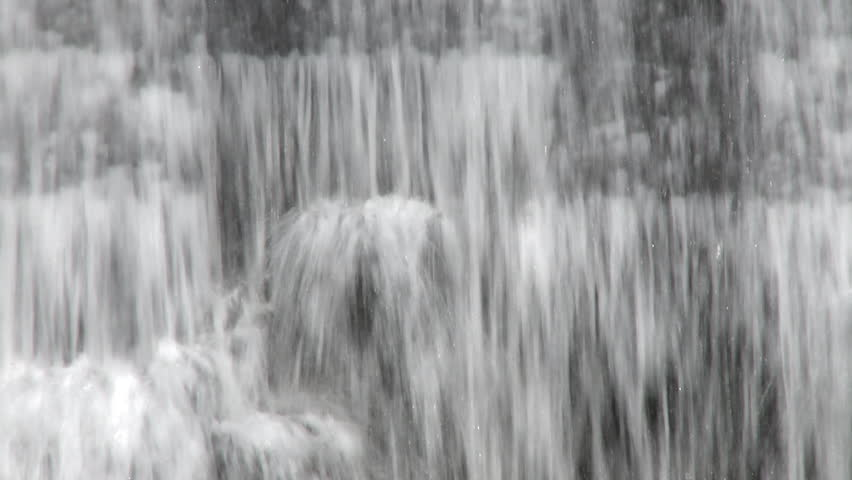 Curtain of water falling over a dam