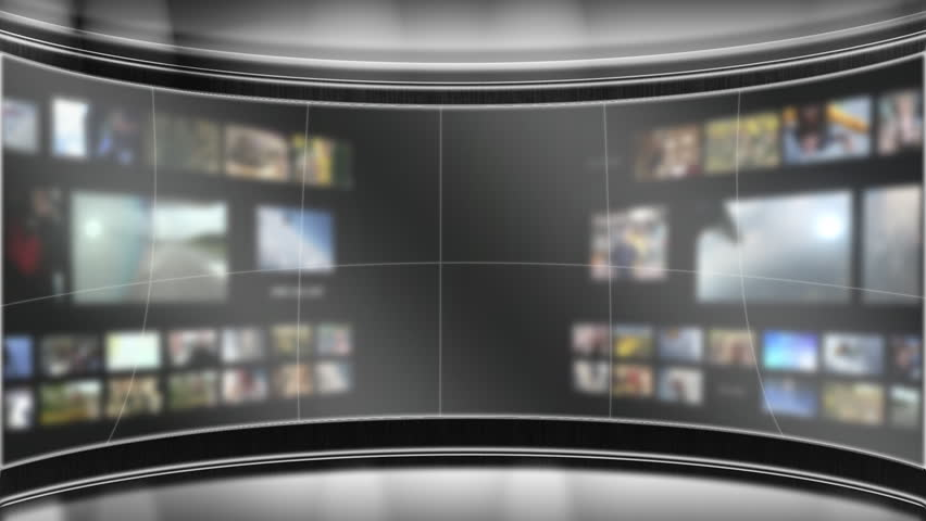 Virtual TV studio set with blurred out background monitors.