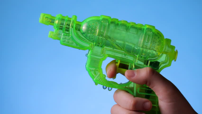Shooting a water pistol