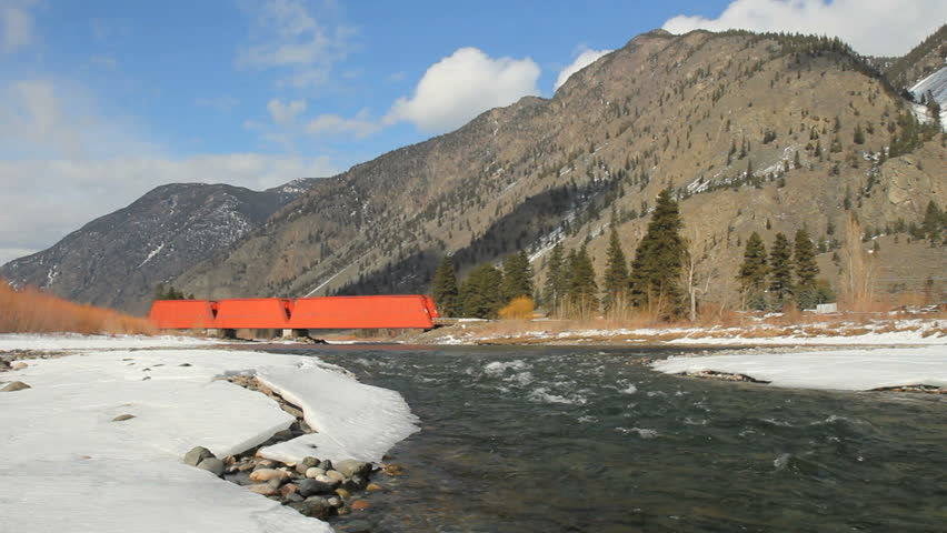 Red Bridge, Keremeos, British Columbia. A red, covered bridge which crosses the Similkameen River near Keremeos. Originally a rail bridge built in 1907. British Columbia, Canada.