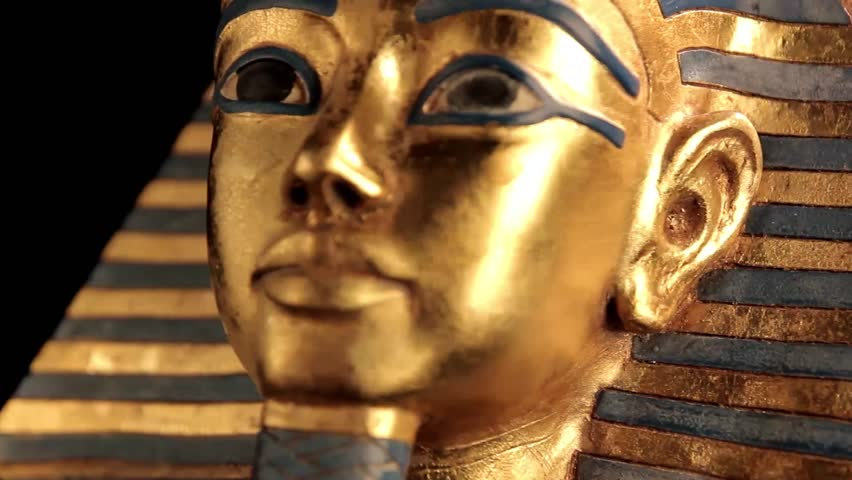 King Tut Sarcophagus rotating over black background closeup - looping video
