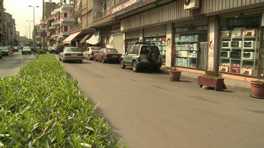 BOURJ HAMMOUD, LEBANON - CIRCA 2001:Medium shot of two lanes with minimal traffic both ways