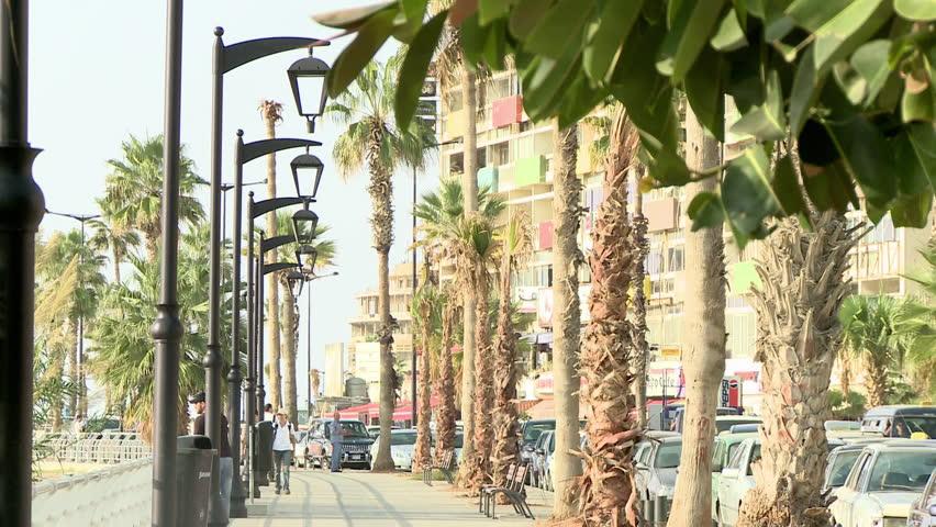 AL RAOUCHE, BEIRUT - CIRCA 2012: people on Corniche walkway - HD stock video