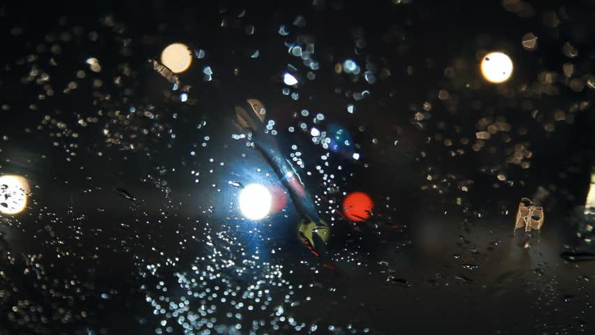 Night road, rain on windshield, bokeh