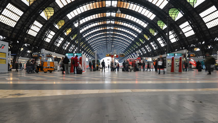 MILAN, ITALY - MARCH 23: (Timelapse View) People walking in Central station on March 23, 2013 in Milan, Italy. Every day about 320,000 passengers pass through the station.